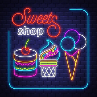 Магазин сладостей - неоновая вывеска вектор. магазин сладостей - неоновая вывеска на фоне кирпичной стены