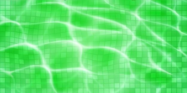 モザイクタイル、日光のまぶしさ、苛性波紋のあるスイミングプールの背景。水面の上面図。緑色で
