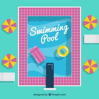 Piscina con un bordo di colore rosa con i galleggianti sfondo