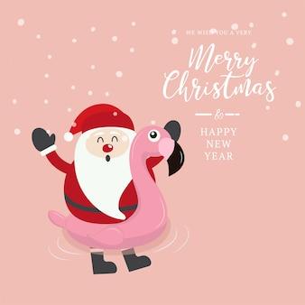 Swimming ring flamingo with santa on christmas background.