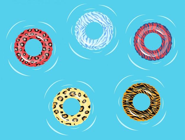 スイミングリング。スイミングプールの夏またはシマウマとヒョウ、トラとキリンの青い海水フローティングチューブリングは、ピンク、黄色、青を印刷します。図