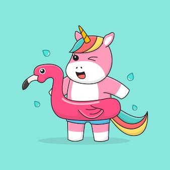 Swimming unicorn with rubber flamingo