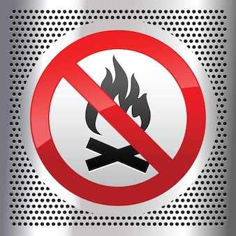 Symbol bonfire on a metallic perforated stainless steel sheet