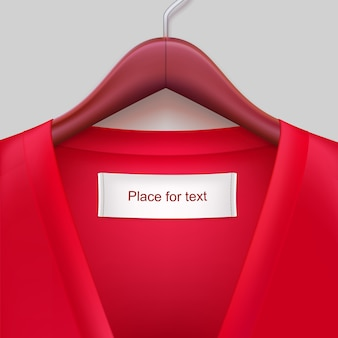 T-shirt with label hanging on a hanger.