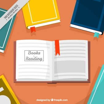 Table background with colored books and open book