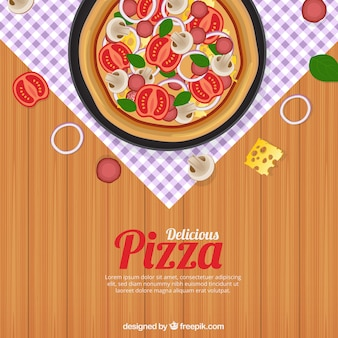 Table background with delicious pizza