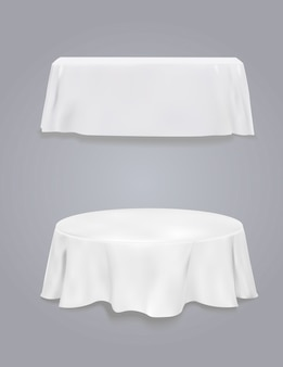 Table with tablecloth on a gray background.