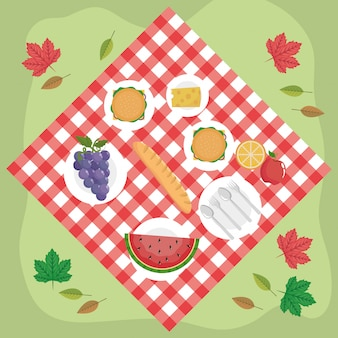 Tablecloth with hamburgers and grapes with watermelon and cheese