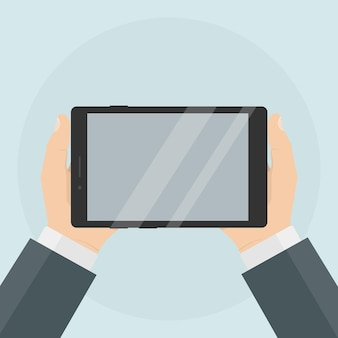 Tablet with blank screen in human hand