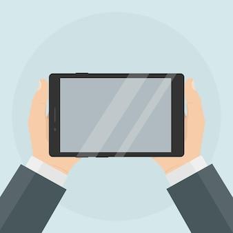 人間の手で空白の画面を持つタブレット