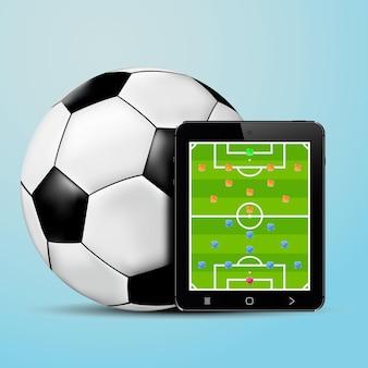 Планшет с экраном формирования футбольной команды и футбольным мячом