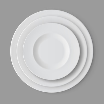 Tableware set of white empty plates isolated, top view