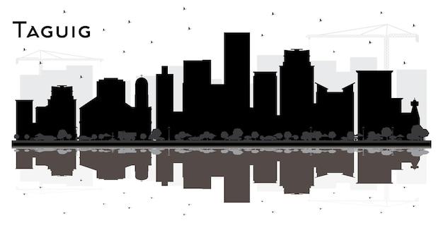 タギッグフィリピンの街のスカイラインの黒と白のシルエットと反射