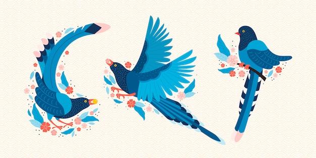 Тайваньская голубая сорока. символ тайваня urocissa caerulea. экзотические птицы тайваня, китая и азии. голубая мультяшная птица и розовые цветы сакуры.