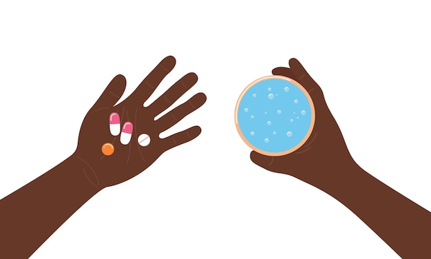 Taking pills medicines in palm top view hands of afican american person holding tablets and water