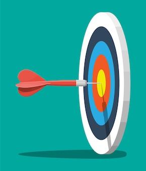 Мишень на деревянном штативе со стрелкой дротика в центре. постановка целей. умная цель. бизнес-целевая концепция. достижение и успех.
