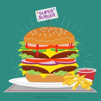 Tasty hamburger with fries and tomato sauce