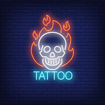 Tattoo neon word with smiling skull in flame outline.