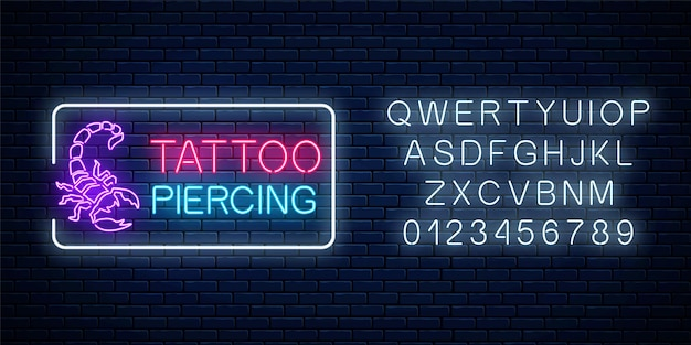 Tattoo and piercing parlor glowing neon signboard with scorpio emblem and alphabet.
