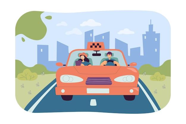 目的地に乗客を連れて行くタクシー運転手