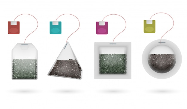 Tea bags with black and green brewing tea isolated  set