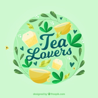 Tea leaves background with cups