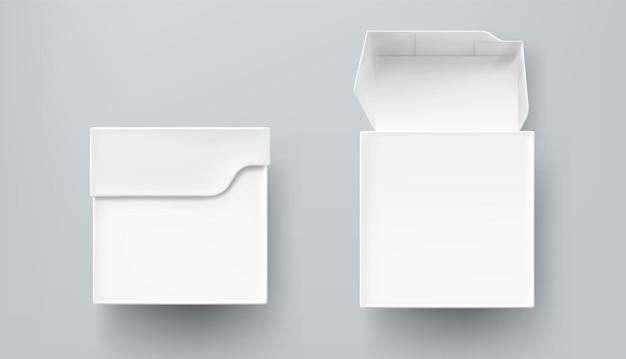 Vista frontale del mockup del pacchetto del tè, della scatola di carta o di cartone