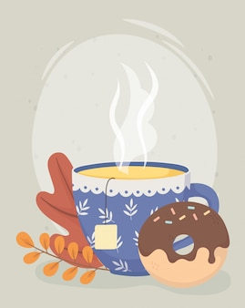 Tea time, tea cup with teabag herbs and sweet donut