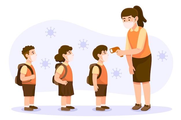 Teacher checking children temperature