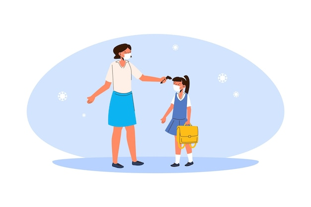 Insegnante che controlla la temperatura dei bambini