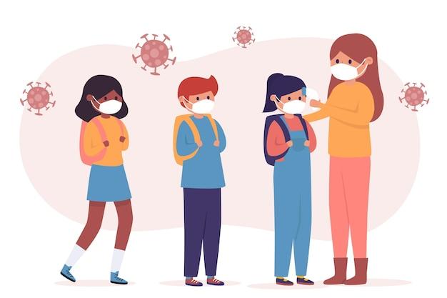 Учитель проверяет температуру детей