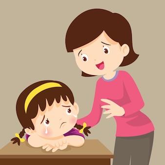 Teacher comforting sad girl