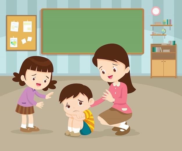 Учитель успокаивает расстроен элементарный грустный ребенок мальчик