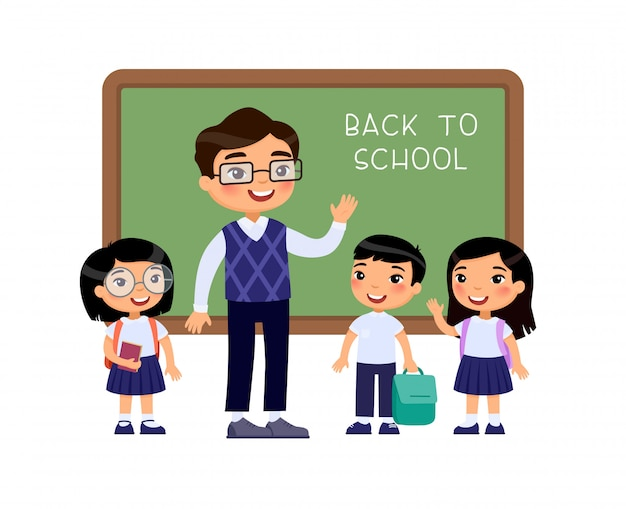 Teacher greeting pupils in classroom flat vector illustration. boys and girls dressed in school uniform and male teacher pointing at blackboard cartoon characters. primary students back to school