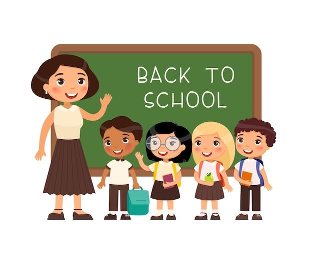 Teacher greeting pupils in classroom international boys and girls dressed in school uniform and fem