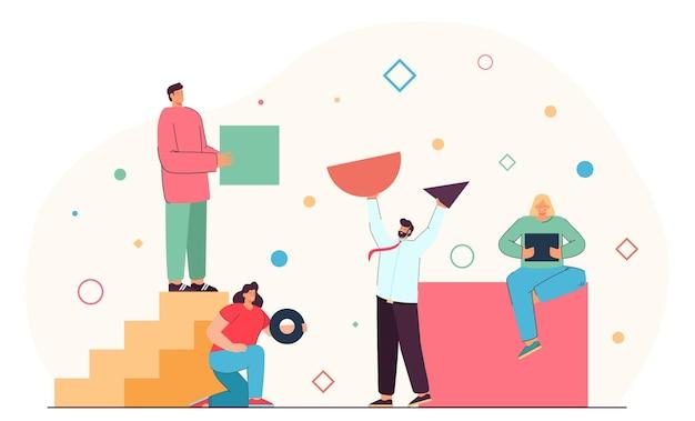 さまざまな形の幾何学的図形を整理する人々のチーム