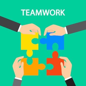 Концепция совместной работы. руки, держащие кусочки головоломки. идея бизнесменов, работающих вместе и идущих к успеху. партнерство и сотрудничество. плоский абстрактный