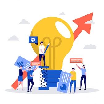 電球の近くに立っている文字とチームワークの概念。創造的な革新と新しいアイデア。