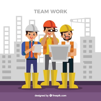 Teamwork concept with construction workers