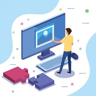 コンピューターとパズルのピースを持つチームワーク男