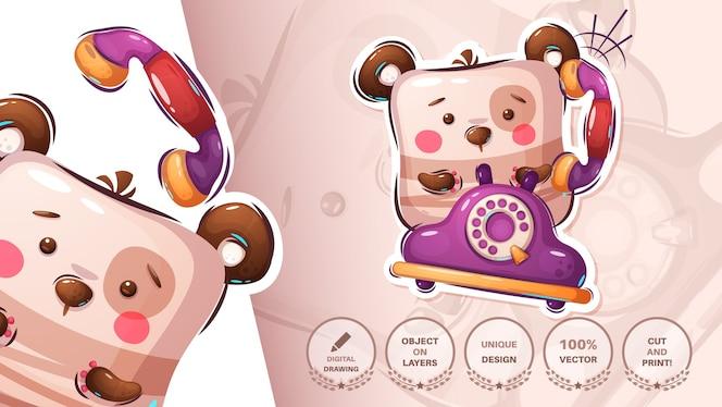 古い電話でテディベアが電話をかける