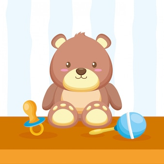 Teddy bear, maraca and pacifier