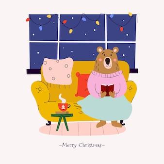 Мишка тедди читает книгу на рождество