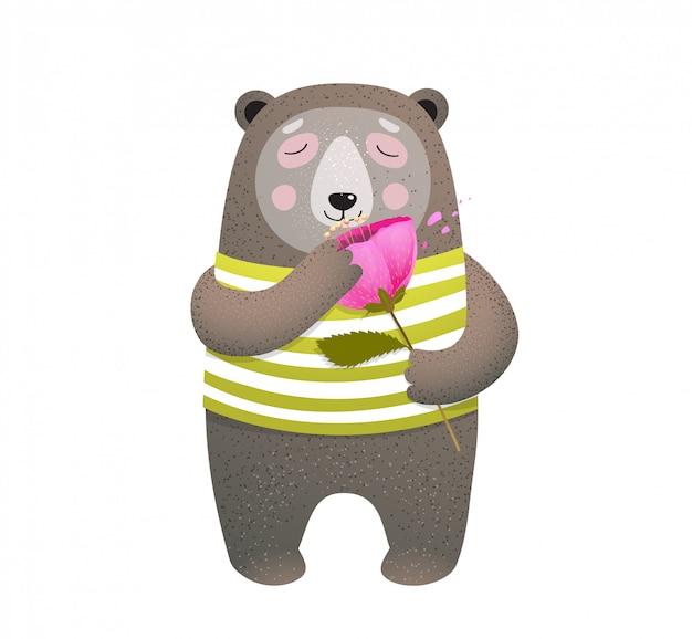 Teddy bear smelling a poppy flower