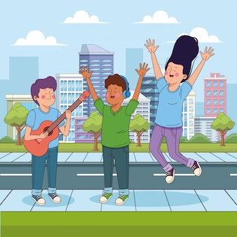 Teenage boy playing guitar and his friends jumping of hapiness