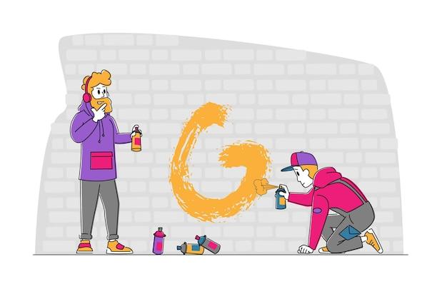 Teenagers painting graffiti on brick wall