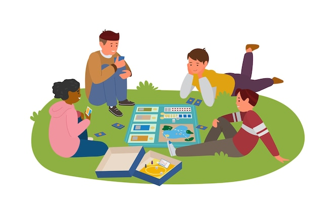 Teenagers playing board game outdoors laying on grass