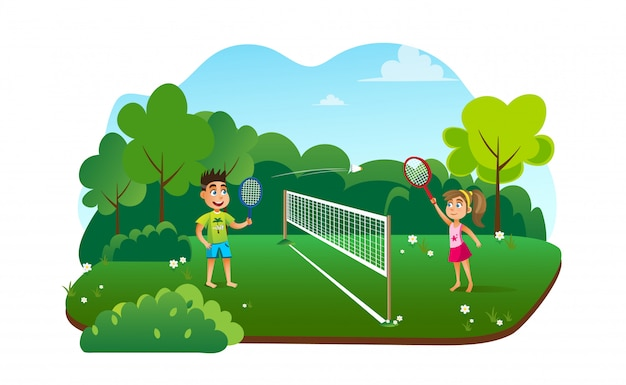 Teens children playing badminton at summer camp.