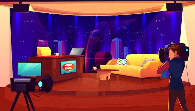 Television studio with camera, lights, table for newscaster, couch for interview and recording tv program, show.
