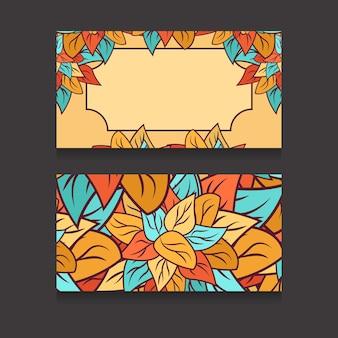 Шаблон визитки с разноцветными листьями и местом для текста